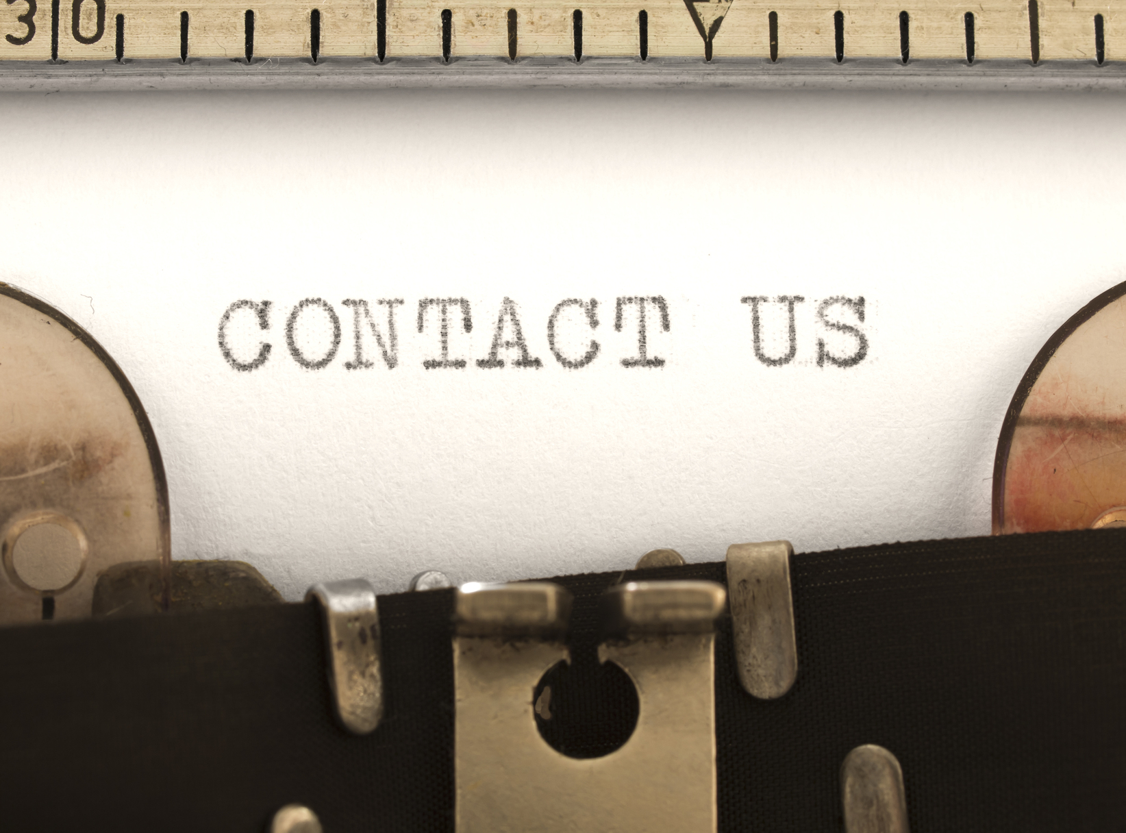 Contact Us title on the typewriter